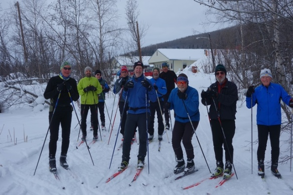 Sonot skiers and volunteers on pond sm